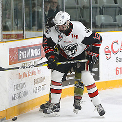 "TRENTON, ON  - MAY 4,  2017: Canadian Junior Hockey League, Central Canadian Jr. ""A"" Championship. The Dudley Hewitt Cup. Game 5 between Powassan Voodoos and the Georgetown Raiders. Matt McJannet #12 of the Georgetown Raiders battles for the puck with  Bo Peltier #6 of the Powassan Voodoos.<br /> (Photo by Tim Bates / OJHL Images)"