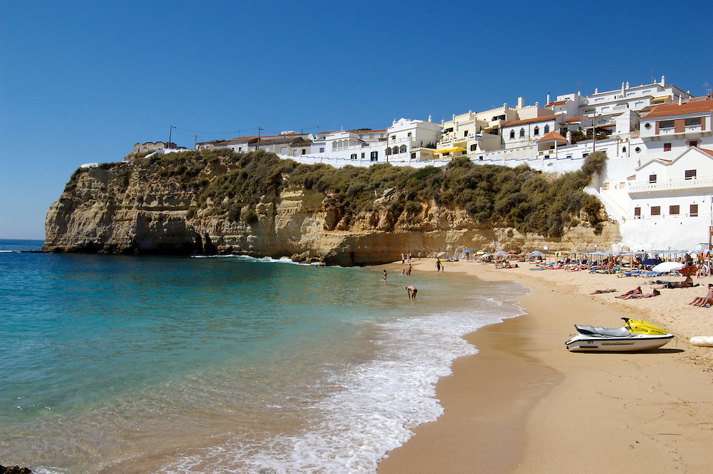 Sunbathers on the beach at Caravoeiro, Algarve, Portugal.