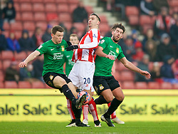 STOKE-ON-TRENT, ENGLAND - Sunday, January 4, 2015: Wrexham's Connor Jennings and Mark Carrington in action against Stoke City's Geoff Cameron during the FA Cup 3rd Round match at the Britannia Stadium. (Pic by David Rawcliffe/Propaganda)