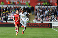 Swansea city's Jonathan de Guzman in action. Barclays Premier league match, Swansea city v Southampton at the Liberty stadium in Swansea, South Wales on Saturday 3rd May 2014.<br /> pic by Andrew Orchard, Andrew Orchard sports photography.