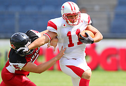 13.07.2011, UPC Arena, Graz, AUT, American Football WM 2011, Group B, Japan (JAP) vs Canada (CAN), im Bild Lirim Hajrullahu (Canada, #5, K) tries to catch Naoki Maeda   (Japan, #11, QB, WR)  // during the American Football World Championship 2011 Group B game, Japan vs Canada, at UPC Arena, Graz, 2011-07-13, EXPA Pictures © 2011, PhotoCredit: EXPA/ T. Haumer