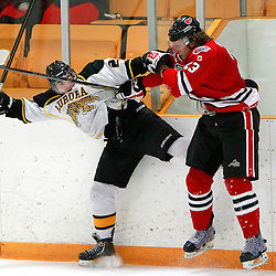 Aurora, ON - Jan 25 : Ontario Junior Hockey League Game Action between the Milton Icehawks and the Aurora Tigers, Patrick Arnold #23 of the Milton Ice Hawks Hockey Club makes the hit on Adam DiBrina #29 of the Aurora Tigers Hockey Club during third period game action.<br /> (Photo by Brian Watts / OJHL Images)