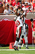 TAMPA, FL - OCTOBER 15:  Wide receiver T.J. Houshmandzadeh #84 of the Cincinnati Bengals goes airborne to catch a 33 yard touchdown pass while defended by cornerback Ronde Barber #20 of the Tampa Bay Buccaneers at Raymond James Stadium on October 15, 2006 in Tampa, Florida. The Bucs defeated the Bengals 14-13. (©Paul Anthony Spinelli) *** Local Caption *** T.J. Houshmandzadeh;Ronde Barber