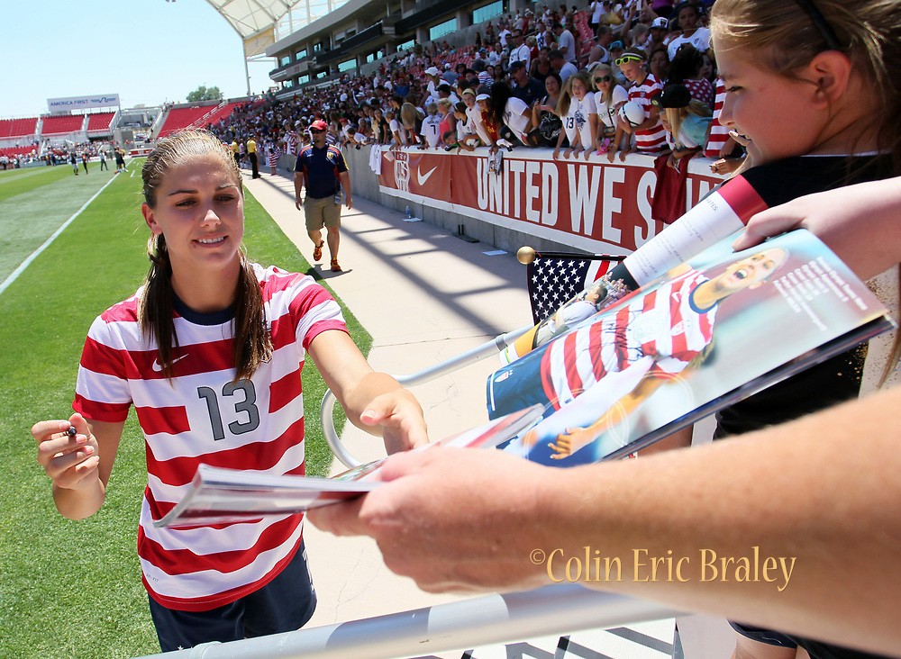 USA's Alex Morgan signs autographs after her team's friendly match against Canada, Saturday, June 30, 2012, in Salt Lake City. USA defeated Canada 2-1. (AP Photo/Colin E Braley)