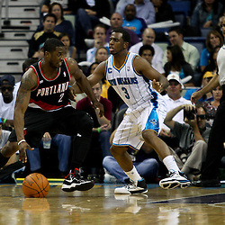 March 30, 2011; New Orleans, LA, USA; Portland Trail Blazers guard Wesley Matthews (2) is guarded by New Orleans Hornets point guard Chris Paul (3) during the first half at the New Orleans Arena.    Mandatory Credit: Derick E. Hingle