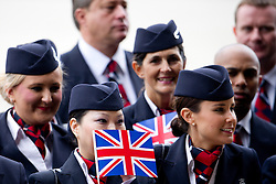04/07/2013 . London, UK.  British Airways staff  wave union flags as they welcome the new British Airways Boeing A380 superjumbo which arrived at Heathrow Airport on July 4, 2013. It was the first time British Airlines have taken delivery of the new plane, making British Airways the first European airline to operate both the 787 and A380. Photo credit : Ben Cawthra/