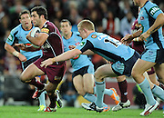 July 6th 2011: Cameron Smith of the Maroons is tackled during game 3 of the 2011 State of Origin series at Suncorp Stadium in Brisbane, QLD, Australia on July 6, 2011. Photo by Matt Roberts / mattrimages.com.au / QRL