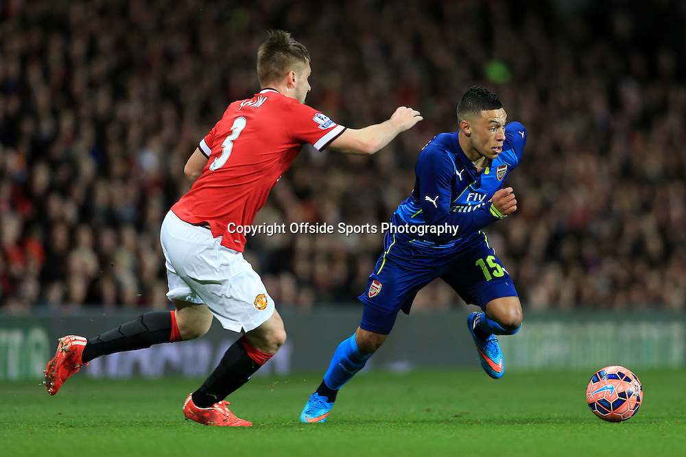 9th March 2015 - FA Cup - Quarter-Final - Manchester United v Arsenal - Alex Oxlade-Chamberlain of Arsenal battles with Luke Shaw of Man Utd - Photo: Simon Stacpoole / Offside.