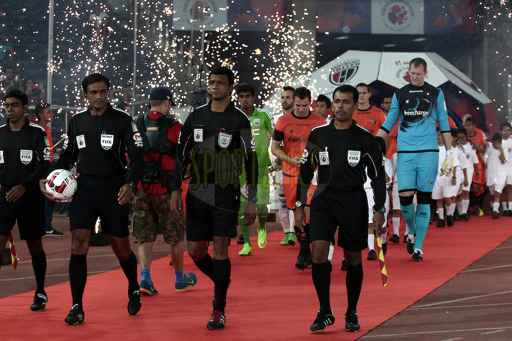Match Referee entering the field during match 16 of the Hero Indian Super League between The Delhi Dynamos FC and NorthEast United FC held at the Jawaharlal Nehru Stadium, Delhi, India on the 29th October 2014.<br /> <br /> Photo by:  Deepak Malik/ ISL/ SPORTZPICS