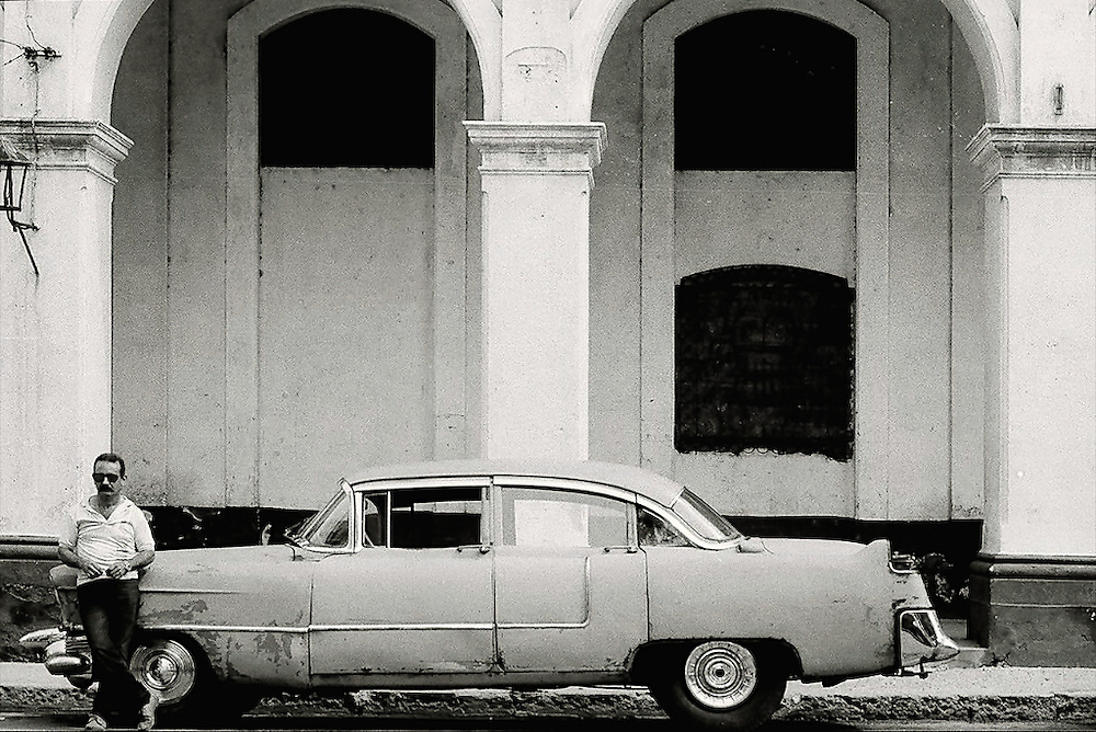 Old car in Havana Cuba. This man was leaning against it and didn't mind me snapping a picture.