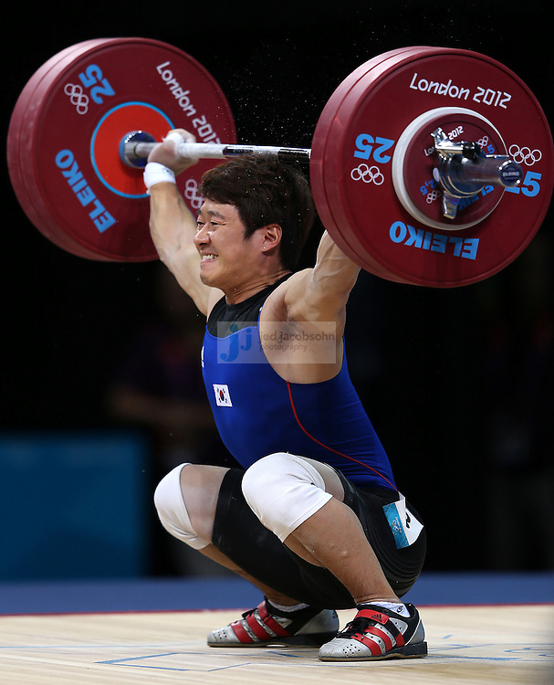 Ji Hun-Min of South Korea attempts to lift 140 kg during the men's 62 kg weightlifting event during day 3 of the London Olympic Games London, 30 Jul 2012..(Jed Jacobsohn/for The New York Times)....