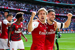 Nacho Monreal and Sead Kolasinac of Arsenal celebrate after winning the penalty shootout to lift the Community Shield - Rogan Thomson/JMP - 06/08/2017 - FOOTBALL - Wembley Stadium - London, England - Arsenal v Chelsea - FA Community Shield.