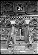 Shiva Parvati temple,  Durbar Square, Kathmandu.<br /> Shiva and Parvati statues looking through a window.