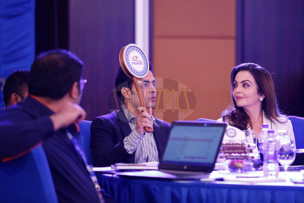 Akash Ambani,Anant Ambani Mumbai Indians owners  and Neeta Ambani Mumbai Indians owners bids during the Vivo IPL 2017 Player Auction held at the Carlton-Ritz hotel in Bangalore on the 20th February  2017<br /> <br /> Photo by Deepak Malik / IPL / SPORTZPICS