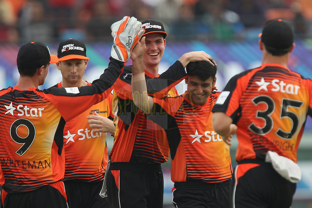 Yasir ARAFAT of the Perth Scorchers celebrates the wicket ofDaryn SMIT of the Dolphins  during match 4 of the Oppo Champions League Twenty20 between the Dolphins and the Perth Scorchers held at the Punjab Cricket Association Stadium, Mohali, India on the 20th September 2014<br /> <br /> Photo by:  Ron Gaunt / Sportzpics/ CLT20<br /> <br /> <br /> Image use is subject to the terms and conditions as laid out by the BCCI/ CLT20.  The terms and conditions can be downloaded here:<br /> <br /> http://sportzpics.photoshelter.com/gallery/CLT20-Image-Terms-and-Conditions-2014/G0000IfNJn535VPU/C0000QhhKadWcjYs