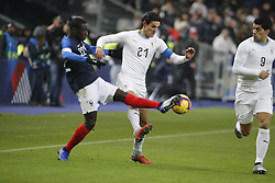 France's Ferland Mendy battling Uruguay's Edinson Cavani during France v Uruguay friendly football match at the Stade de France in Saint-Denis, suburb of Paris, France on November 20, 2018. France won 1-0. Photo by Henri Szwarc/ABACAPRESS.COM