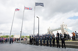 © London News Pictures. 22/06/15. London, UK. Boris Johnson stands with current members of the British military during a ceremony to honour UK Armed Forces, Central London. Photo credit: Laura Lean/LNP