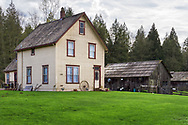 Annand/Rowlatt farmhouse on a spring day.  The farmhouse was built in 1888 - Joseph and Sarah Anne Annand sold the farm in 1905, and Len Rowlatt first leased, then purchased the property and lived there for almost 60 years. The Annand/Rowlatt farmhouse is one of the oldest existing houses in the Township of Langley.  The farmhouse and surrounding buildings are now part of Campbell Valley Regional Park in Langley, British Columbia, Canada.