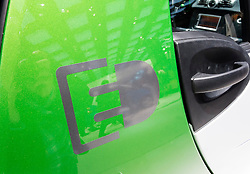 Detai of electric car plug-in symbol on electric SMART car at Paris Motor Show 2012