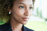 Woman outdoors looking away close-up