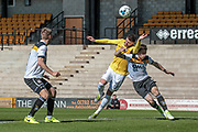 Gary Madine (Bolton Wanderers) wins the header under pressure but cannot direct it towards the Port Vale goal during the EFL Sky Bet League 1 match between Port Vale and Bolton Wanderers at Vale Park, Burslem, England on 22 April 2017. Photo by Mark P Doherty.