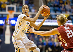 West Virginia Mountaineers guard Jessica Morton (21) looks to get past Oklahoma Sooners guard Gabbi Ortiz (21) during the first half at the WVU Coliseum.