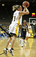 28 NOVEMBER 2007: Iowa guard Kristi Smith (11) puts up a shot in the first half of Georgia Tech's 76-57 win over Iowa in the Big Ten/ACC Challenge at Carver-Hawkeye Arena in Iowa City, Iowa on November 28, 2007.