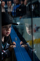 KELOWNA, CANADA - DECEMBER 28: A young fan watches the warm up between the Kelowna Rockets and the Kamloops Blazers on December 28, 2015 at Prospera Place in Kelowna, British Columbia, Canada.  (Photo by Marissa Baecker/Shoot the Breeze)  *** Local Caption *** fans
