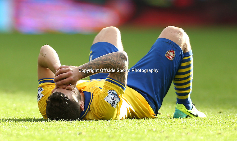 6th October 2013 - Barclays Premier League - West Bromwich Albion v Arsenal - Jack Wilshere of Arsenal lies dejected - Photo: Simon Stacpoole / Offside.
