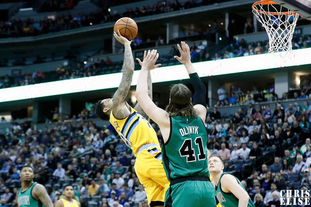 10 March 2017: Denver Nuggets forward Wilson Chandler (21) takes a jump shot against Boston Celtics center Kelly Olynyk (41) during the Denver Nuggets 119-99 victory over the Boston Celtics, at the Pepsi Center, Denver, Colorado, USA.