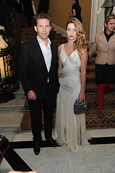 NICK CANDY and actress ANNABELLE WALLACE at the launch of the Claridge's Christmas Tree designed by John Galliano for Dior held at Claridge's, Brook Street, London on 1st December 2009.