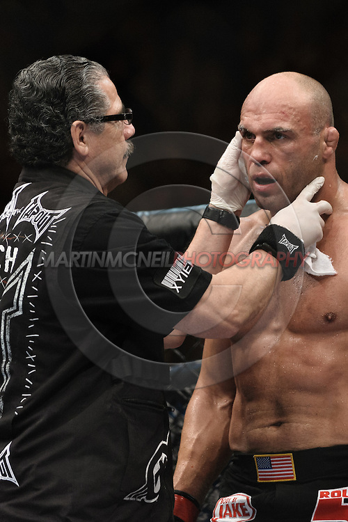 "MANCHESTER, ENGLAND, NOVEMBER 14, 2009: Cutman Jacob Duran (left) checks over Randy Couture between rounds during ""UFC 105: Couture vs. Vera"" inside the MEN Arena in Manchester, United Kingdom"