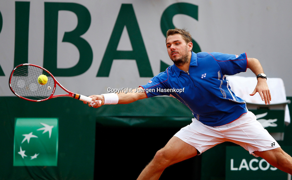French Open 2013, Roland Garros,Paris,ITF Grand Slam Tennis Tournament, Stanislas Wawrinka (SUI),<br /> Aktion,Einzelbild,Halbkoerper,Querformat,