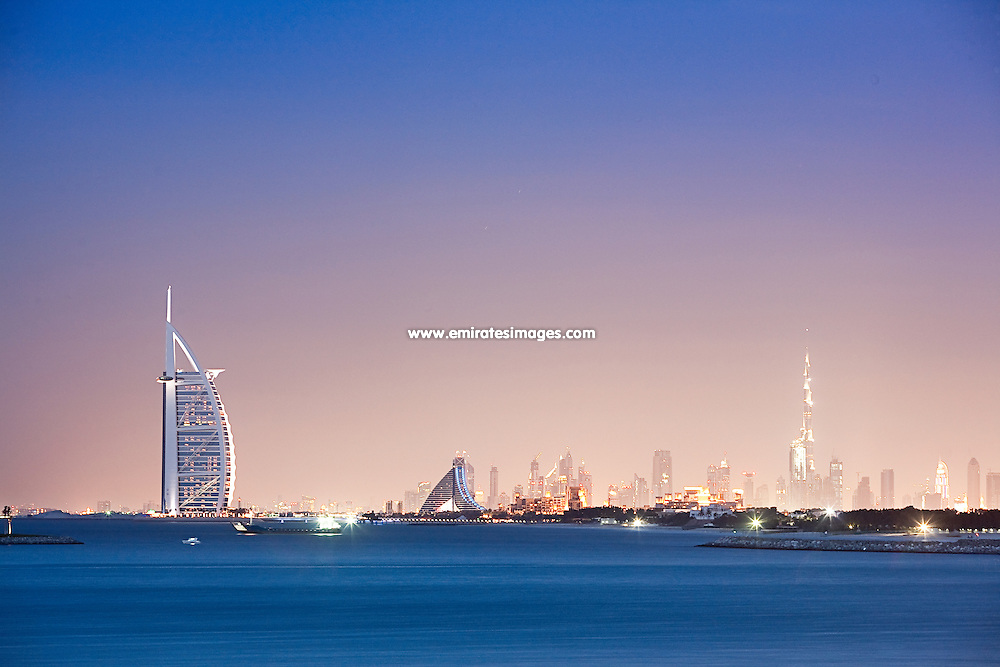 Dubai skyline from Palm Jumeirah, including the iconic Burj Al Arab hotel, Jumeirah Beach Hotel and Burj Khalifa in the distance