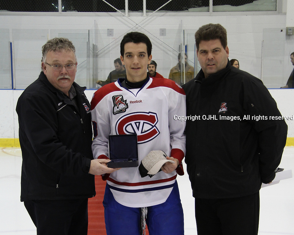 KINGSTON,ON-Jan 30 :<br />  Ontario Junior Hockey League, Regular season game between Kingston Voyageurs and Mississauga Chargers.Player of the month recipient Brett Seney #13 of the Kingston Voyageurs Hockey Club receiving his award from team owner Al Paterson and OJHL Executive Rob MacGregor. (Photo by Robert John Boucher / OJHL Images)