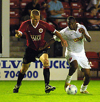 Photo: Dave Linney.<br />Walsall FC v Manchester United XI. Pre Season Friendly. 18/07/2006Walsall's .Hector Sam(R) battles with  Ryan Shawcross