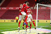 Middlesbrough midfielder George Saville (22) celebrates with Middlesbrough forward Ashley Fletcher (11), Middlesbrough defender Djed Spence (29) and Middlesbrough midfielder Marcus Tavernier (7) after scoring his team's first goal during the EFL Sky Bet Championship match between Middlesbrough and Charlton Athletic at the Riverside Stadium, Middlesbrough, England on 7 December 2019.
