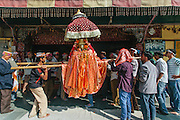 Deity waiting to take blessings from Lord Raghunath at his temple in Kullu, Himachal Pradesh, India. Kullu Dussehra is the Dussehra festival observed in the month of October in Himachal Pradesh state in northern India. It is celebrated in the Dhalpur maidan in the Kullu valley. Dussehra at Kullu commences on the tenth day of the rising moon, i.e. on 'Vijay Dashmi' day itself and continues for seven days. Its history dates back to the 17th century when local King Jagat Singh installed an idol of Raghunath on his throne as a mark of penance. After this, god Raghunath was declared as the ruling deity of the Valley.