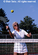 Outdoor recreation, tennis, Tennis, Friendly Competition, Senior Female Plays Tennis