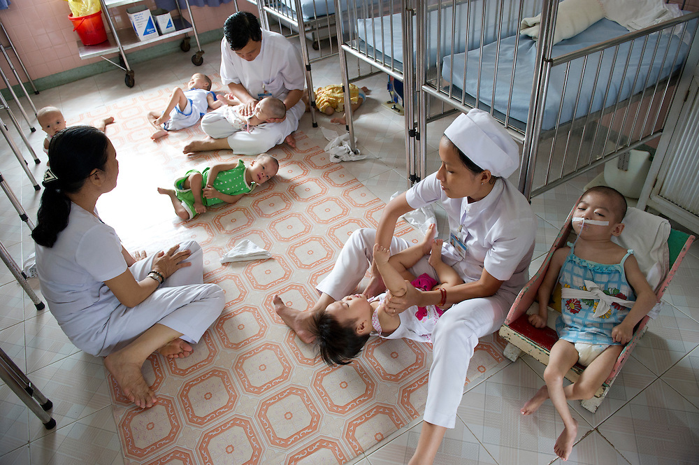 Physical therapy on sick children within the Peace Village at the Tu Du (Freedom) Obstetrics and Gynaecology Hospital in Ho Chi Minh City, Vietnam