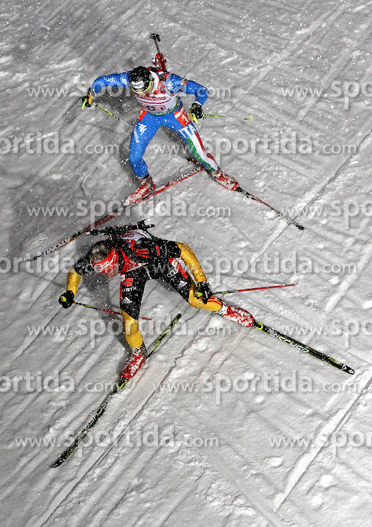 05.01.2012, DKB-Ski-ARENA, Oberhof, GER, E.ON IBU Weltcup Biathlon 2012, Staffel Herren, im Bild Simon Schempp (GER) vor Christian De Lorenzi (ITA) // during relay Mens of E.ON IBU World Cup Biathlon, Thüringen, Germany on 2012/01/05. EXPA Pictures © 2012, PhotoCredit: EXPA/ nph/ Hessland..***** ATTENTION - OUT OF GER, CRO *****
