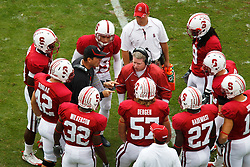 October 23, 2010; Stanford, CA, USA;  Stanford Cardinal head coach Jim Harbaugh (fourth from left) talks to his kick off team before the game against the Washington State Cougars at Stanford Stadium.