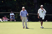 16 July 2006 Billy Mayfair and his caddy contemplate an extremely long putt on the 9th hole. The John Deere Classic is played at TPC at Deere Run in Silvis Illinois, just outside of the Quad Cities