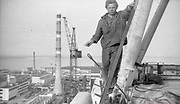 """AMAZING Photo Film discovered Documenting Work In Chernobyl <br />Chernobyl worker Aleksandr Shubovskiy captures rare images <br /><br />During one of the days in 1979-80, when the erection of Ventilation Stack VT-2 common for the third and fourth (not existed at that time) Chernobyl NPP Units was coming to the end, Aleksandr Shubovskiy, who was working within a combined installation crew in a company named """"Spetsenergomontazh"""", arranged with the colleagues a small photo session on his own,They had their pictures taken.<br /><br />The author processed the film and put it on a wardrobe without printing until he had time to print the images. The moment to print the film somehow did not happen, while in February 1986 Aleksandr hit the road for a on a different site in Yakutia. And there he was caught by news about the accident at Chernobyl.<br /><br />A year later, when a Aleksandr  managed to get into his looted flat in the evacuated Pripyat, he discovered an untouched package with films. He brought them home and… forgot for almost 40 years…the printed photographs which no one and never have seen before until now<br /><br />Photo shows: Against all H&S rules. At height with a cigarette but without any safety.<br />©Aleksandr Shubovskiy/Exclusivepix Media"""