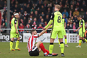 Exeter City forward Robbie Simpson (8) gives a helping hand to Lincoln City defender Luke Waterfall (5) during the EFL Sky Bet League 2 match between Lincoln City and Exeter City at Sincil Bank, Lincoln, United Kingdom on 30 March 2018. Picture by Mick Atkins.