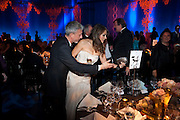 PATRICK COX; ELIZABETH HURLEY; STEPHEN FRY, Grey Goose character and cocktails. The Elton John Aids Foundation Winter Ball. off Nine Elms Lane. London SW8.  chef Marcus Wareing was in charge of dinner.30 October 2010. -DO NOT ARCHIVE-© Copyright Photograph by Dafydd Jones. 248 Clapham Rd. London SW9 0PZ. Tel 0207 820 0771. www.dafjones.com.