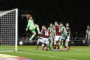 Wimbledon nearly take the lead as Paul Robinson of AFC Wimbledon sees is header hit the post and the rebound is gathered by Adam Smith (goalkeeper) of Northampton Town FC during the Sky Bet League 2 match between Northampton Town and AFC Wimbledon at Sixfields Stadium, Northampton, England on 1 March 2016. Photo by Stuart Butcher.