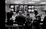 Group of teenagers in Wendy's fast food outlet, London, UK, 1984