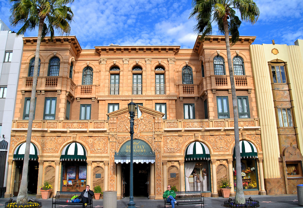 Beverly Wilshire Hotel Fa&ccedil;ade at Universal in Orlando, Florida<br /> A quick look at this photo and you might mistake it for the real Beverly Wilshire Hotel on the corner of South Rodeo Drive and Wilshire Boulevard in Beverly Hills. The builders at Universal Florida created a masterful reproduction of this 1928 Italian Renaissance fa&ccedil;ade.  The real hotel was the home to several celebrities including John Lennon, Warren Beatty and Elvis Presley. Today this exquisite property in California is a Four Seasons Hotel. In the Florida version, it seems to be a favorite spot for husbands to sit on a bench and rest.