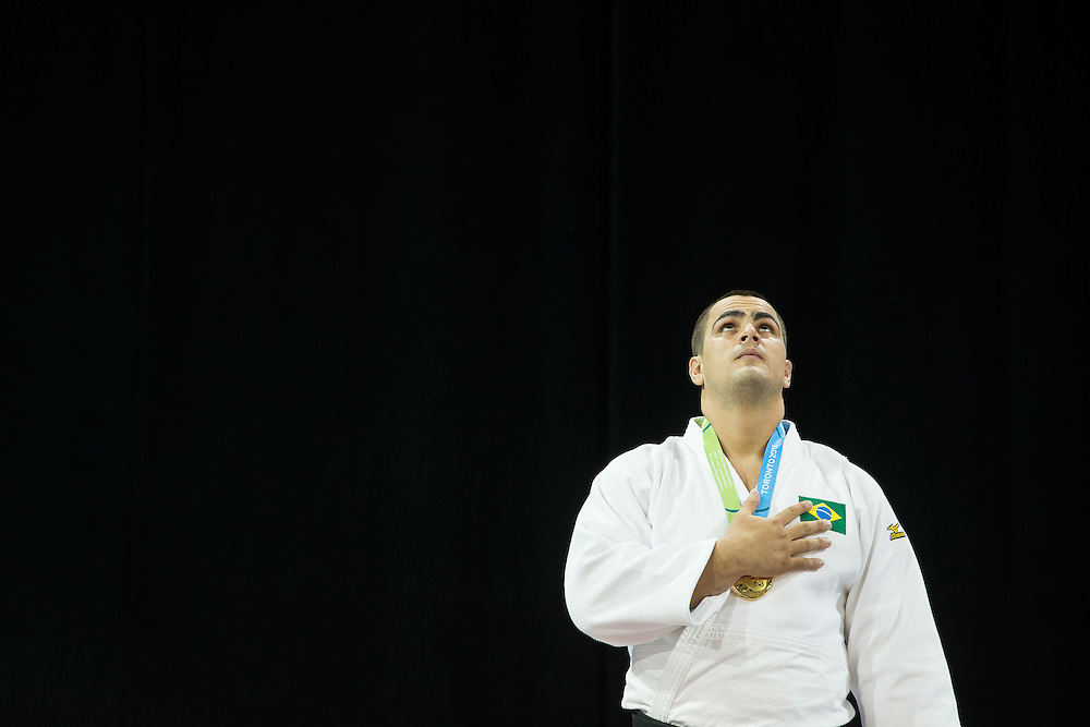 Gold medalist David Moura of Brazil looks skyward during the Brazilian national anthem during the medal ceremony for the men's judo +100kg class at the 2015 Pan American Games in Toronto, Canada, July 14,  2015.  AFP PHOTO/GEOFF ROBINS